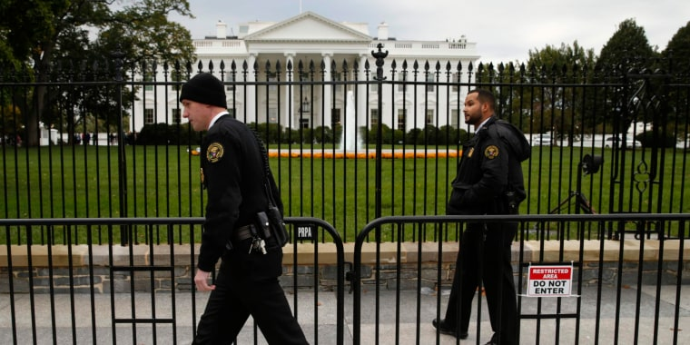 Image: Members of the U.S. Secret Service patrol in front of the North Lawn of the White House in Washington