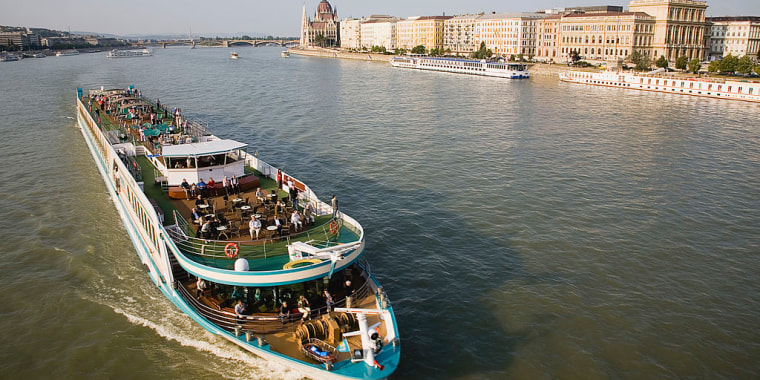 Pleasure cruise boat on the River Danube approaching Szechenyi Chain Bridge