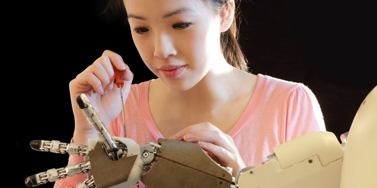 woman working on robot hand