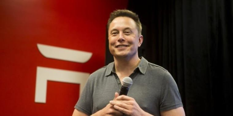 Tesla CEO Elon Musk speaks about new Autopilot features during a Tesla event in Palo Alto, California