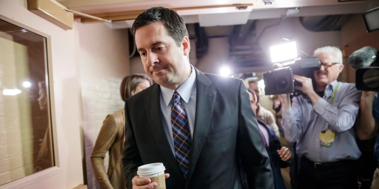 Image: Devin Nunes is pursued by reporters as he arrives for a weekly meeting