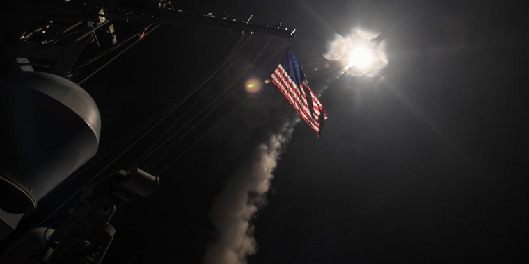 Image: The guided-missile destroyer USS Porter fires a Tomahawk land attack missile in the Mediterranean Sea