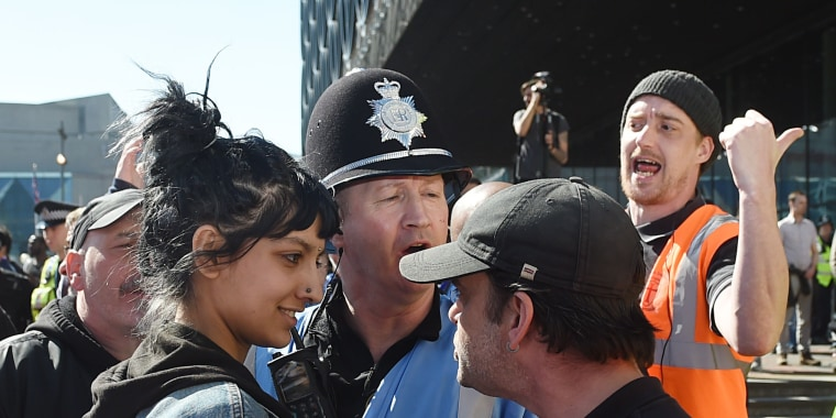 Image: Saffiyah Khan staring down an English Defence League protester during a demonstration in Birmingham