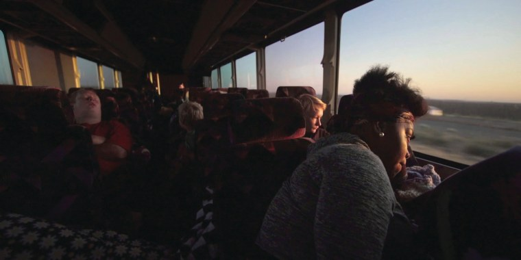 "Daybreak on an overnight bus that takes children to visit their parents in prison is shown in a still taken from ""Mother's Day."""
