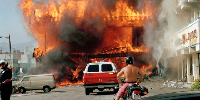Image: A Korean shopping mall burns at Third Street and Vermont Avenue in Los Angeles