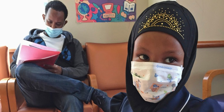 Image:  Amira Hassan,of Burnsville, Minn., plays in the waiting room at the specialty clinic at Children's Minnesota in Minneapolis