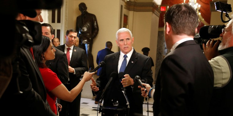 Image: U.S. Vice President Mike Pence speaks to reporters at the U.S. Capitol in Washington