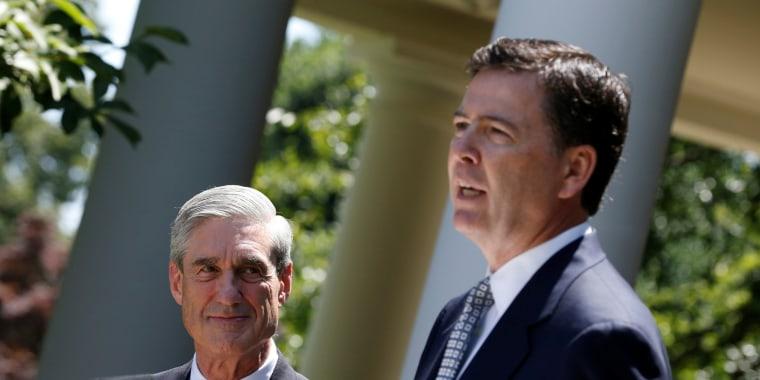 Image: James Comey speaks alongside outgoing FBI Director Robert Mueller at the White House in Washington