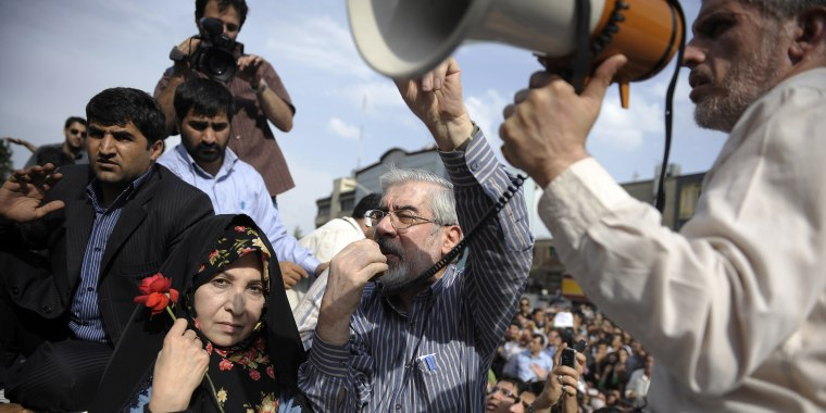 Image: Mir Hossein Mousavi addresses supporters as he attends a rally in June 2009