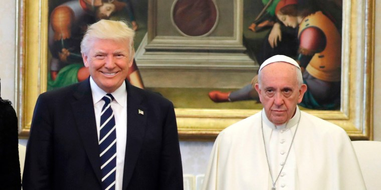 Image: Pope Francis poses with US President Donald Trump, First Lady Melania Trump and Ivanka Trump at the end of a private audience at the Vatican