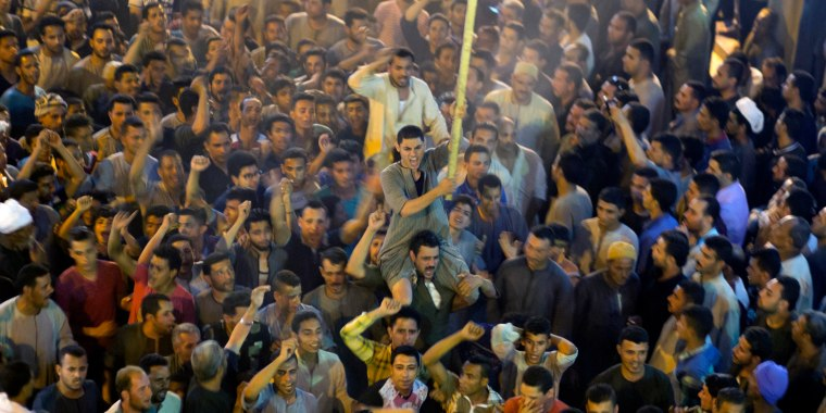 Image: Coptic Christians shout after the funeral of some of the victims of the bus attack.