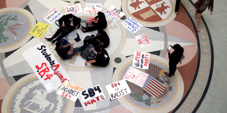 In this April 26, 2017, file photo, students gather in the Rotunda at the Texas Capitol to oppose SB4.