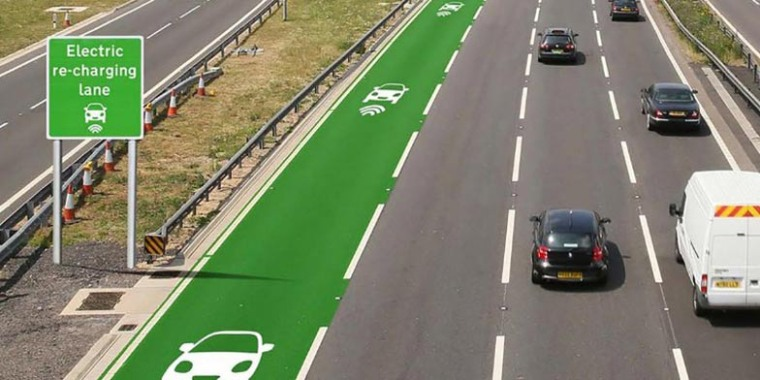 An artist's rendering shows a highway lane that charges electric vehicles as they drive.