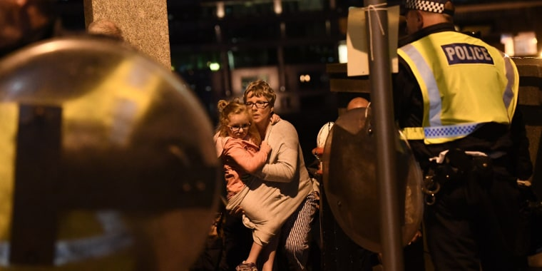 Image: People are lead to safety on Southwark Bridge away from London Bridge after an attack on June 3, 2017 in London, England. Police have responded to reports of a van hitting pedestrians on London Bridge in central London.