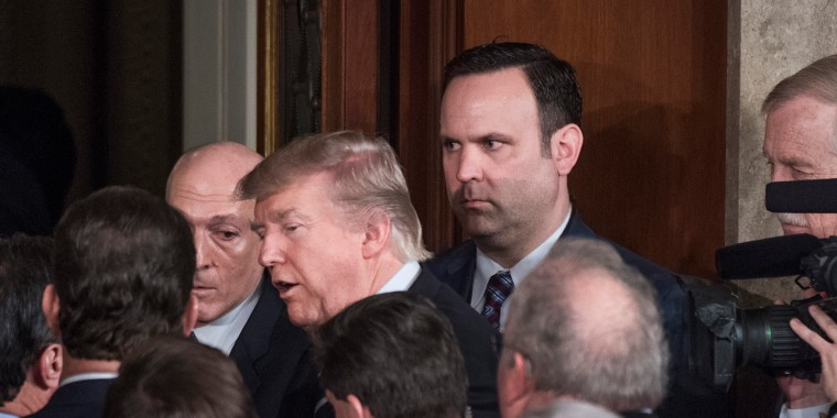 Image: White House aide Dan Scavino looks on as President Trump leaves the Capitol's House Chamber