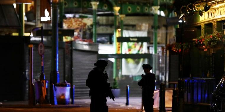 Image: Armed police patrol near Borough Market following an attack near London Bridge