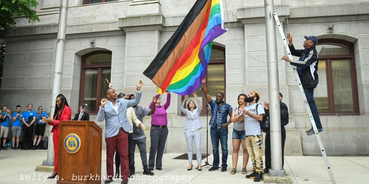 Philadelphia's new rainbow Pride flag, which includes black and brown stripes, is raised at City Hall in June 2017