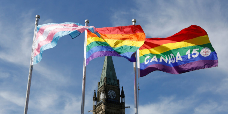 Image: The transgender pride, pride and Canada 150 pride flags fly on Parliament Hill in Ottawa