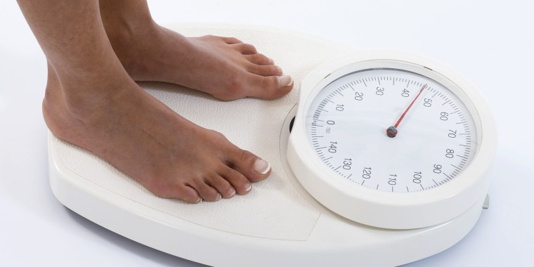 Image: Creative Image of Woman on Weight Scale