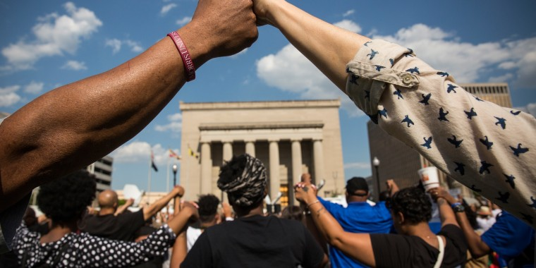 Activists Rally At Baltimore City Hall