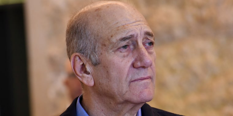 FILE -- In this Dec. 29, 2015 file photo, former Israeli Prime Minister Ehud Olmert leaves the courtroom of the Supreme Court after the court ruled on his appeal in the Holyland corruption case in Jerusalem.