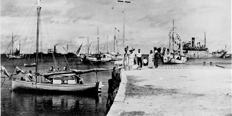 Image: A photo discovered in the National Archives shows a woman who resembles Amelia Earhart on a dock in the Marshall Islands