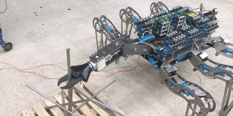 A screenshot of a video of Latro equipped with an arm carrying a hydraulic cutter