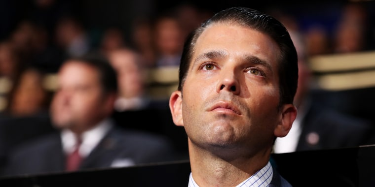 Image: Donald Trump Jr. listens to a speech on the first day of the Republican National Convention