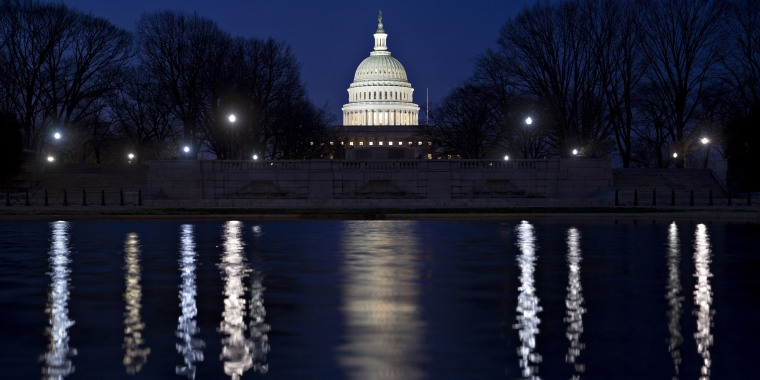 Image: The U.S. Capitol building stands before sunrise in Washington