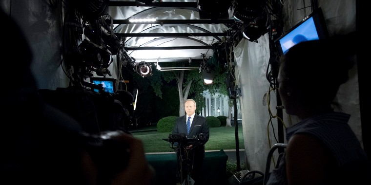 Image: White House Press Secretary Sean Spicer talks to reporters about the firing of FBI Director James Comey earlier in the day, outside the White House in Washington, May, 9, 2017.