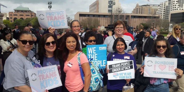 "A group of ""Mamma Bears"" and other allies at a rally at the Texas State Capitol in Austin, Texas, on March 6, 2017. Front row (L-R): Maria Clinkscales, Carrie Kinghorn, Angie Castro, Danny Castro, Laura Venegas and Roxy Castro. Back row (L-R):  Brandi Spear and Michele Pettigrew."