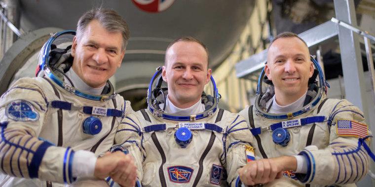 Expedition 52 flight engineers Paolo Nespoli of the European Space Agency, left, Sergey Ryazanskiy of Roscosmos, and Randy Bresnik of NASA outside a Soyuz simulator.