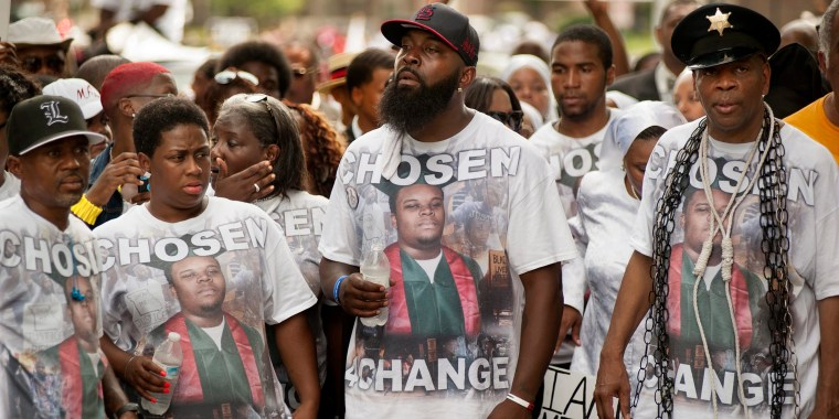 Image: Moment of silence, rally held on one-year anniversary of shooting death of Michael Brown Jr.