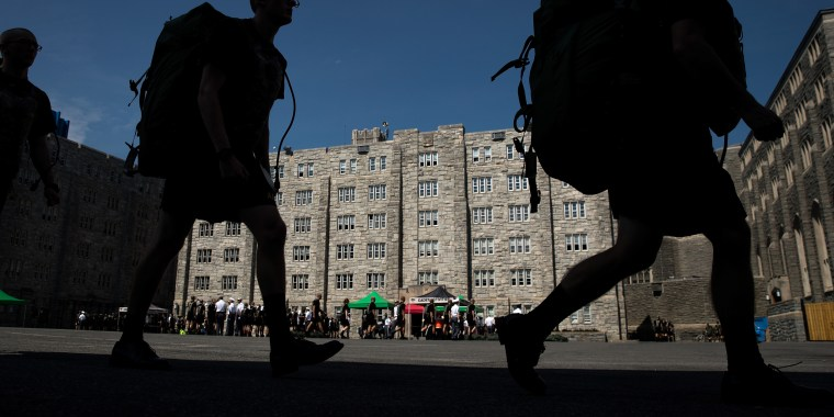 Image: New cadets march in a courtyard on campus at West Point