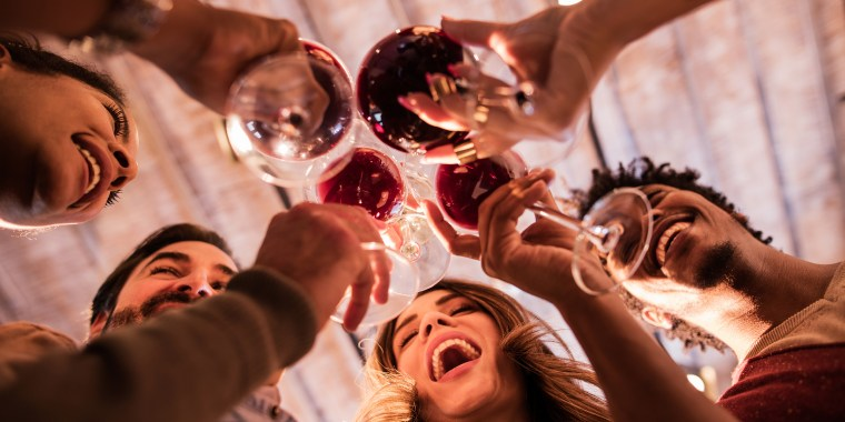 Image: Below View of Group of Friends Toasting with Wine