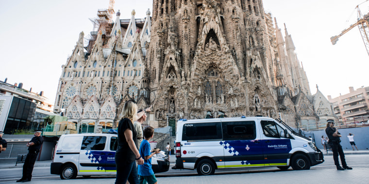 Image: Guards watch over La Sagrada Familia in Barcelona.