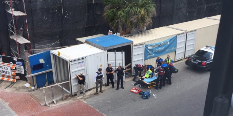 Image: First responders and police surround an injured person in Charleston, South Carolina