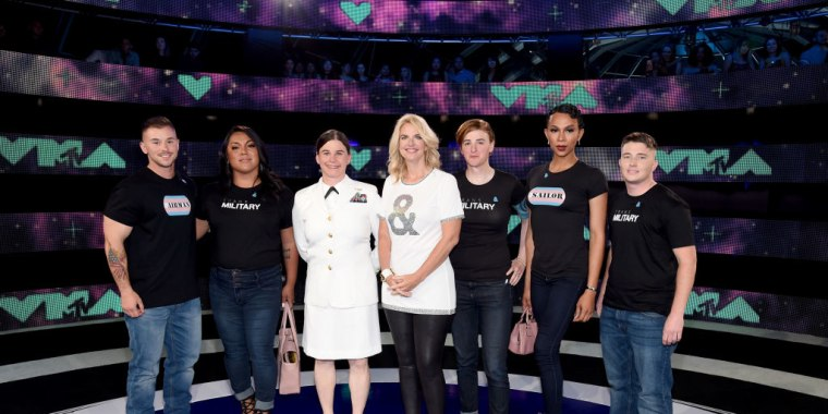 President of GLAAD Sarah Kate Ellis (center) and transgender military members attend the 2017 MTV Video Music Awards at The Forum on August 27, 2017 in Inglewood, California.