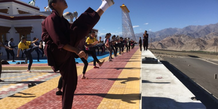 Girls from India's Ladakh region practice kicking with a group of nuns who practice kung fu.
