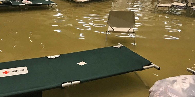 Water fills the Bob Bower Civil Center in Port Arthur, Texas, where evacuees had been taking shelter.