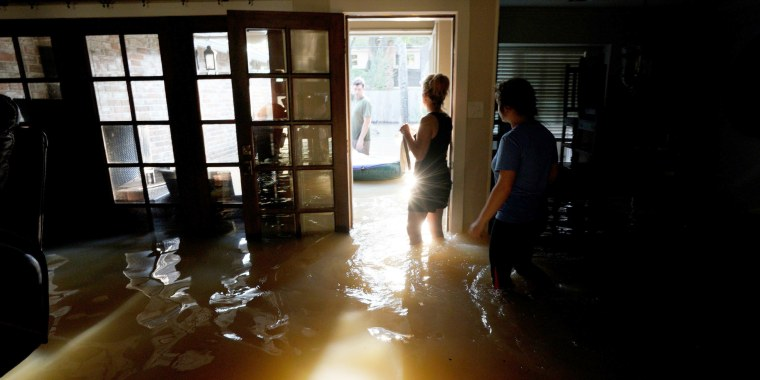 Image: A family that wants to remain anonymous moves belongings from their home flooded by Harvey in Houston, Texas, Aug. 31, 2017.