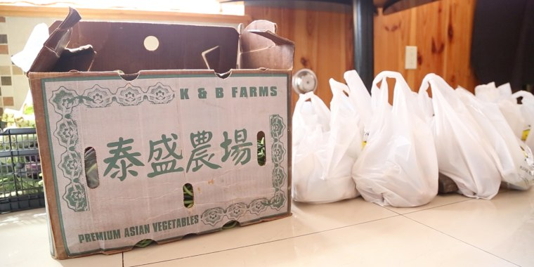 Produce in bags at East Asian Fusion restaurant in New Jersey, a pick-up point for Weee!, a group buying startup that uses the social messaging app WeChat.