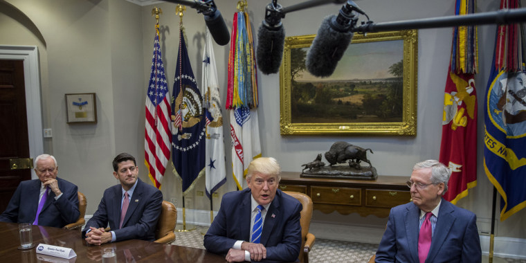 Image: Donald Trump delivers remarks during a meeting with members of Congress and his administration regarding tax reform