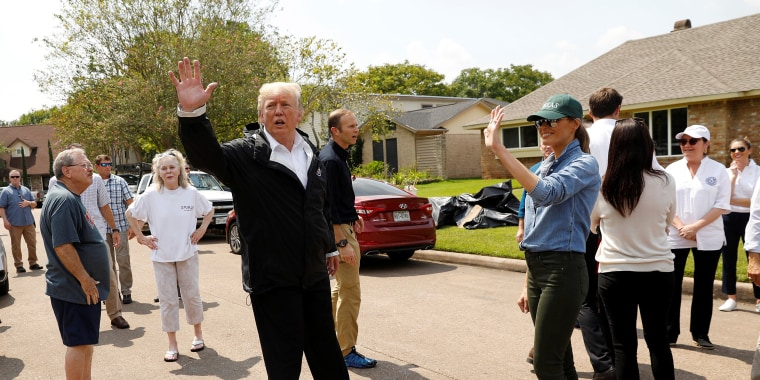 Image: U.S. President Donald Trump and first lady Melania Trump greet residents in a neighborhood during a visit with flood survivors and volunteers during recovery efforts of Hurricane Harvey in Houston