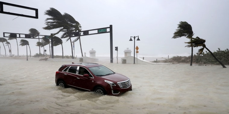 Image: A car sits abandoned in storm surge from Hurricane Irma