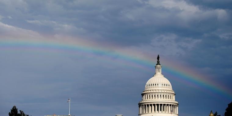 Image: A rainbow shines over the U.S. Capitol in Washington