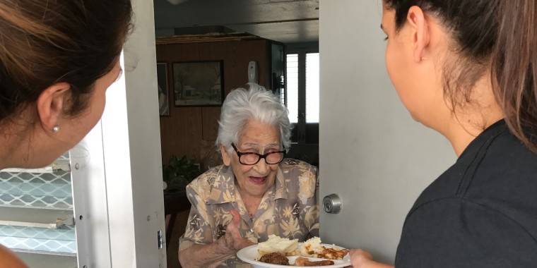 Volunteers deliver food to the elderly in Miami post hurricane Irma.