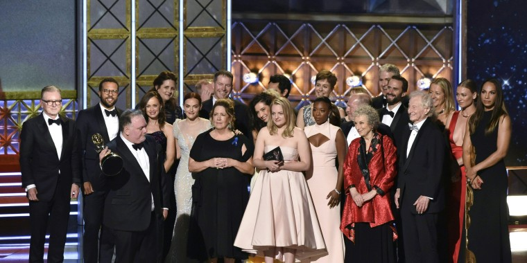 """Image: The cast and crew of """"The Handmaid's Tale"""" accept the award for Outstanding Drama Series"""