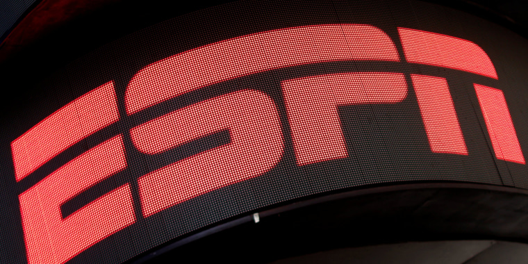 Image: The ESPN logo is seen on an electronic display in Times Square in New York City