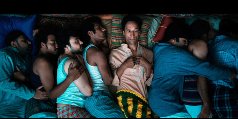 "Danny Pudi (center) stars as Sami Malik, an immigrant living in a very cramped Chicago apartment, in ""The Tiger Hunter."""